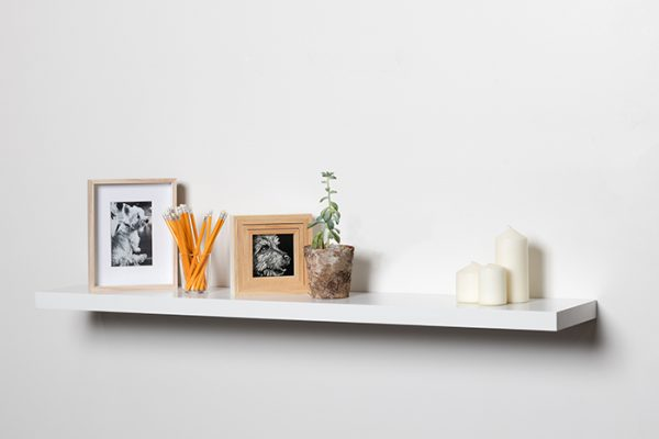 Flexi Storage Decorative Shelving Floating Shelf White Gloss 1200 x 240 x 38mm fitted on wall with decorations on top