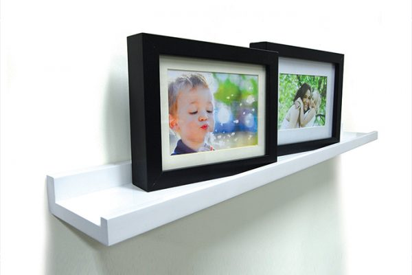 Flexi Storage Decorative Shelving Photo Shelf 600x100x35mm fitted on wall with several photos on the shelf