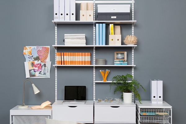 Flexi Storage Home Solutions Timber Shelf White 600x200x16mm mounted on Home Solutions Double Slot System and used as shelving in office setup
