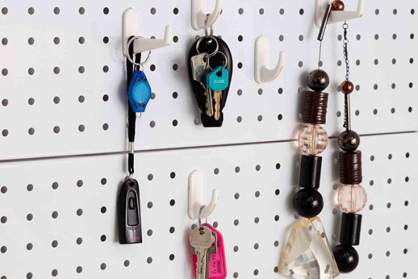 Flexi Storage Home Solutions Pegboard Hooks Small White fitted to Home Solutions Pegboard with various items hanging
