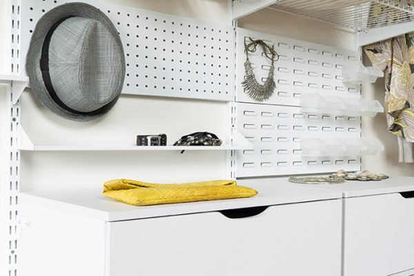 Flexi Storage Home Solutions Pegboard White fitted in a wardrobe setup